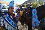 Miss Warm Springs Thyreicia Simtustus prepares her horse Sting for the horse parade to mark Kah-Nee-Ta's last weekend.