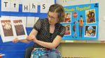 Kindergarten teacher Alia Woolfe reads to her students.